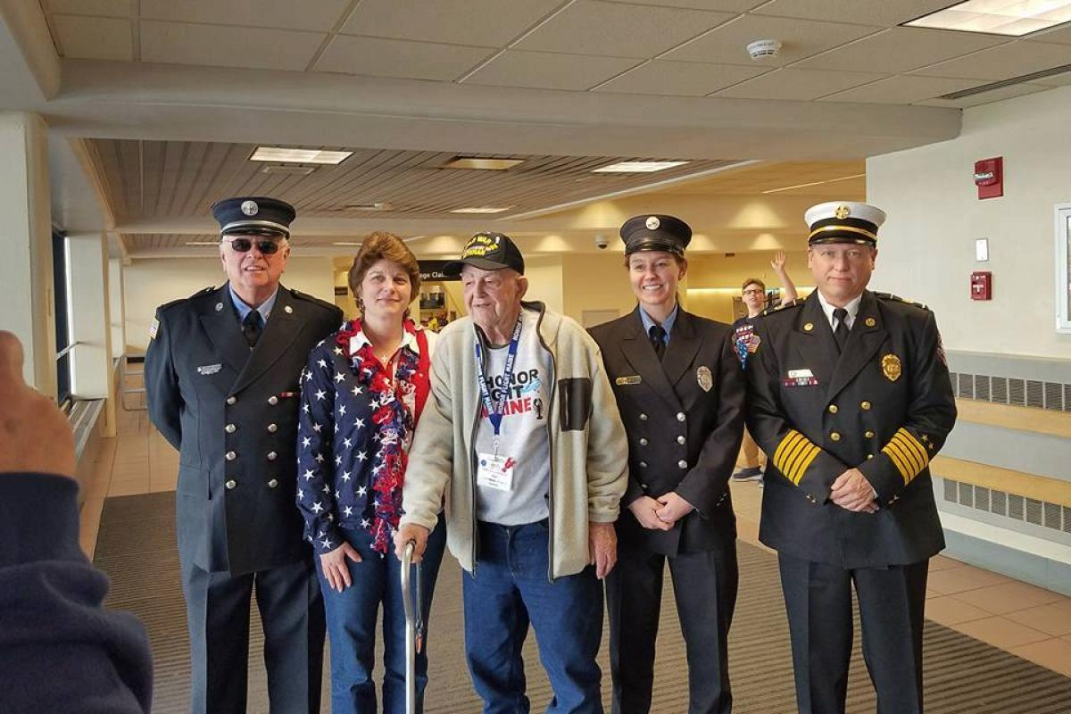 Escorting WWII Navy Veteran, Ed Hanson, home from his Honor Flight Maine (S. Geary, D. Grover, A. Smith & G. Payson)