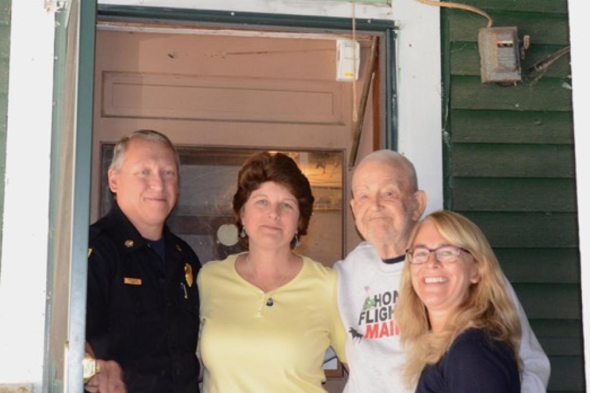 Veteran Ed Hanson receives 1st Knox Box:  Chief Payson, Town Clerk Debbie Grover & Lori Parham (AARP ME)