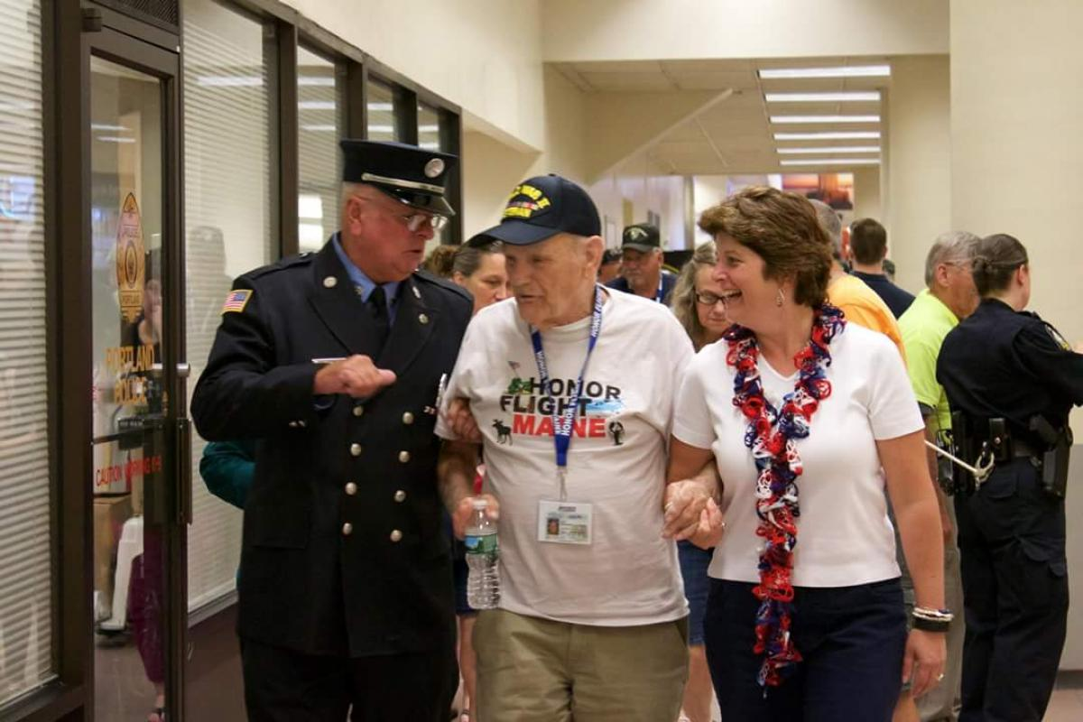 Escorting WWII Army Airborne Veteran, Silas Peaslee, home from his Honor Flight Maine with Steve Geary & Debbie Grover