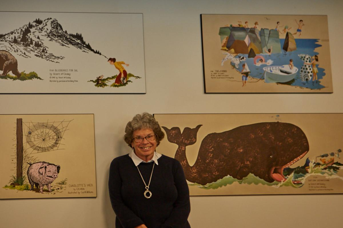 Artist Sue Clukey with her murals